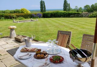 Sussex wine tour and tasting and lunch on vineyard estate garden